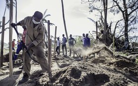 Worker digs latrine in Mozambique
