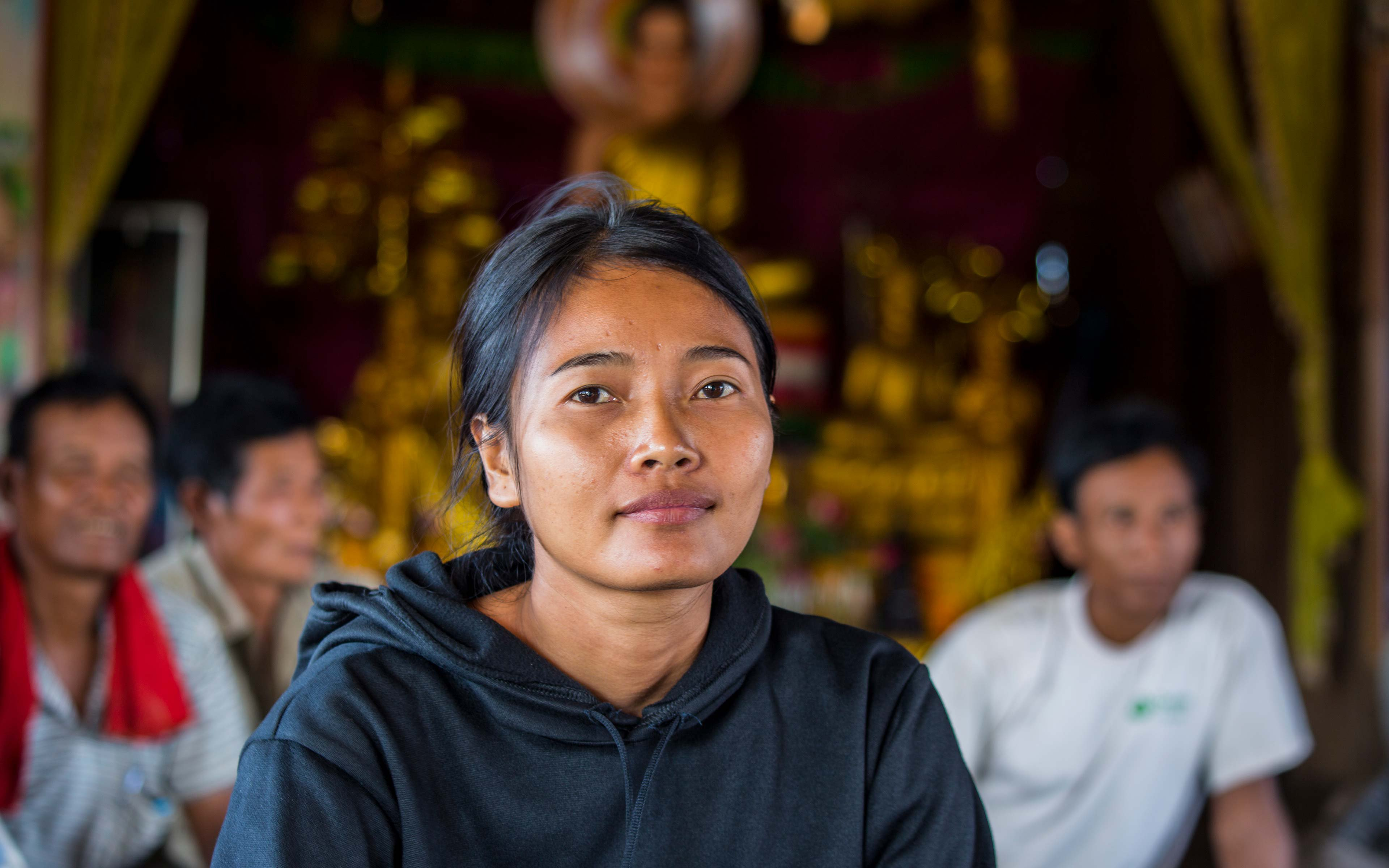Hong Rany helps to lead a training workshop on fishing regulations at her village pagoda. When she was elected leader of the Community Fishery committee some of the men quit in protest, but since then she says she has re-organized the group and has proven she can lead it effectively.