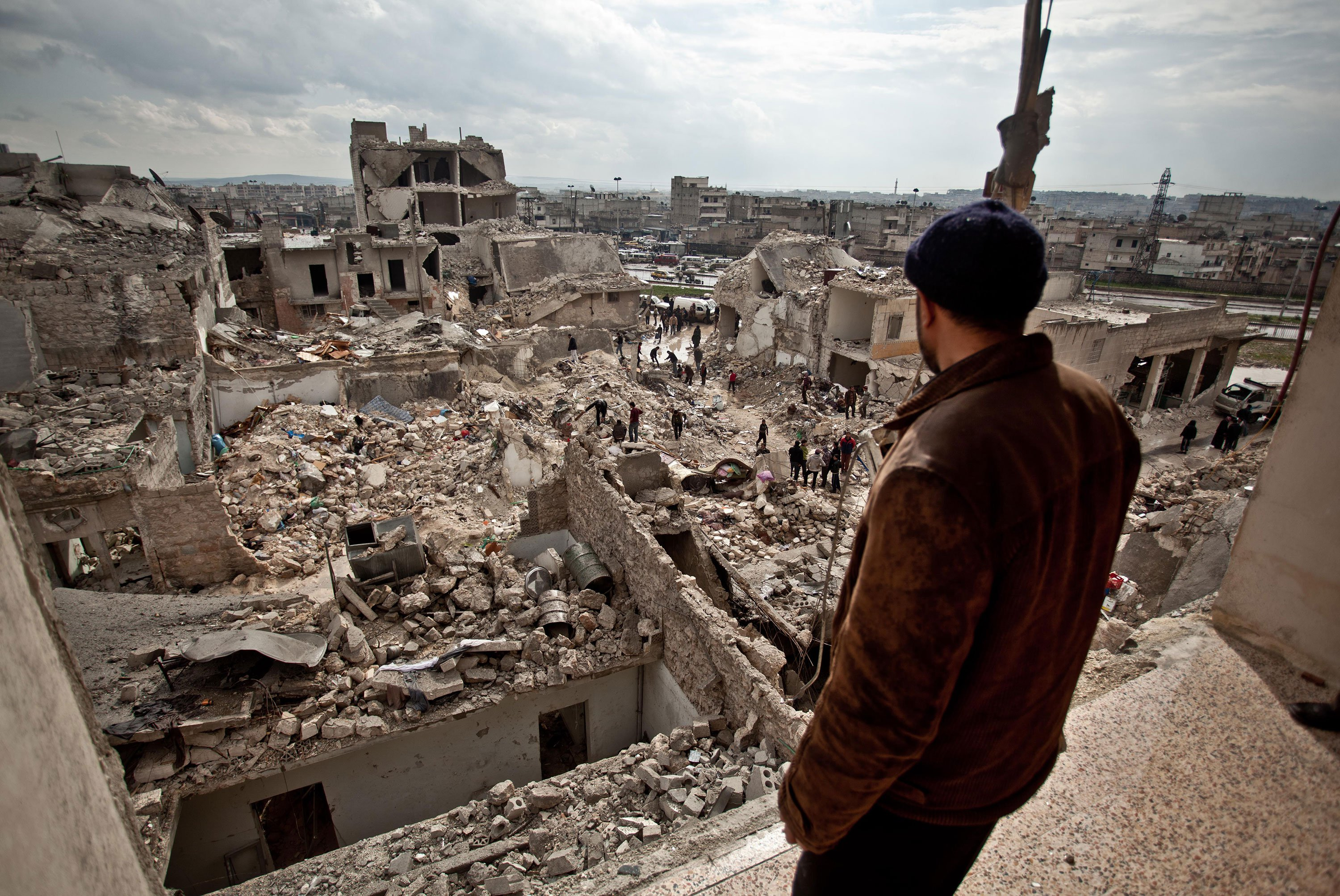 The view over Aleppo, Syria, shows a neighborhood destroyed by war. The conflict there has displaced 11 million people.