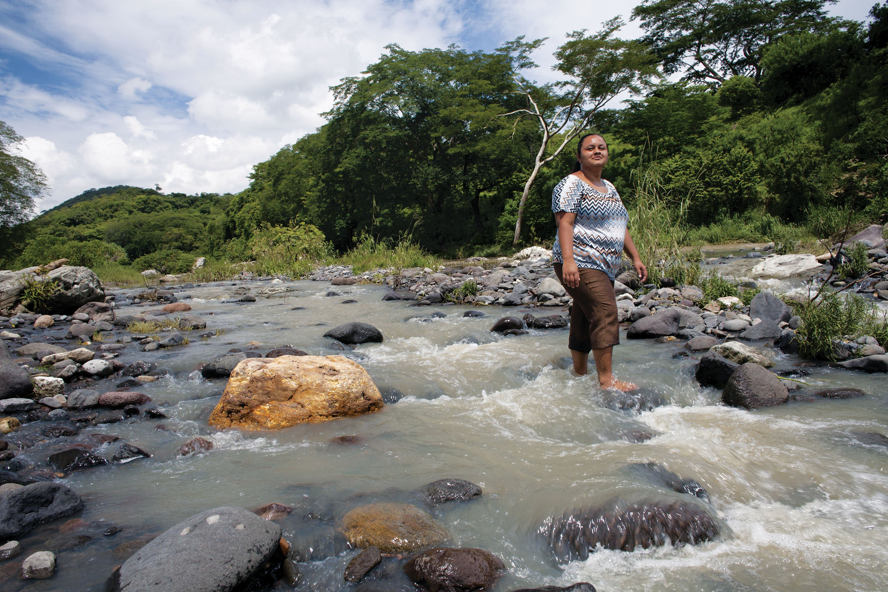 Daysi Carillo walks in the Titihuapa River. Farmers in this area of northern El Salvador feared a proposed gold mine would pollute this vital water source.