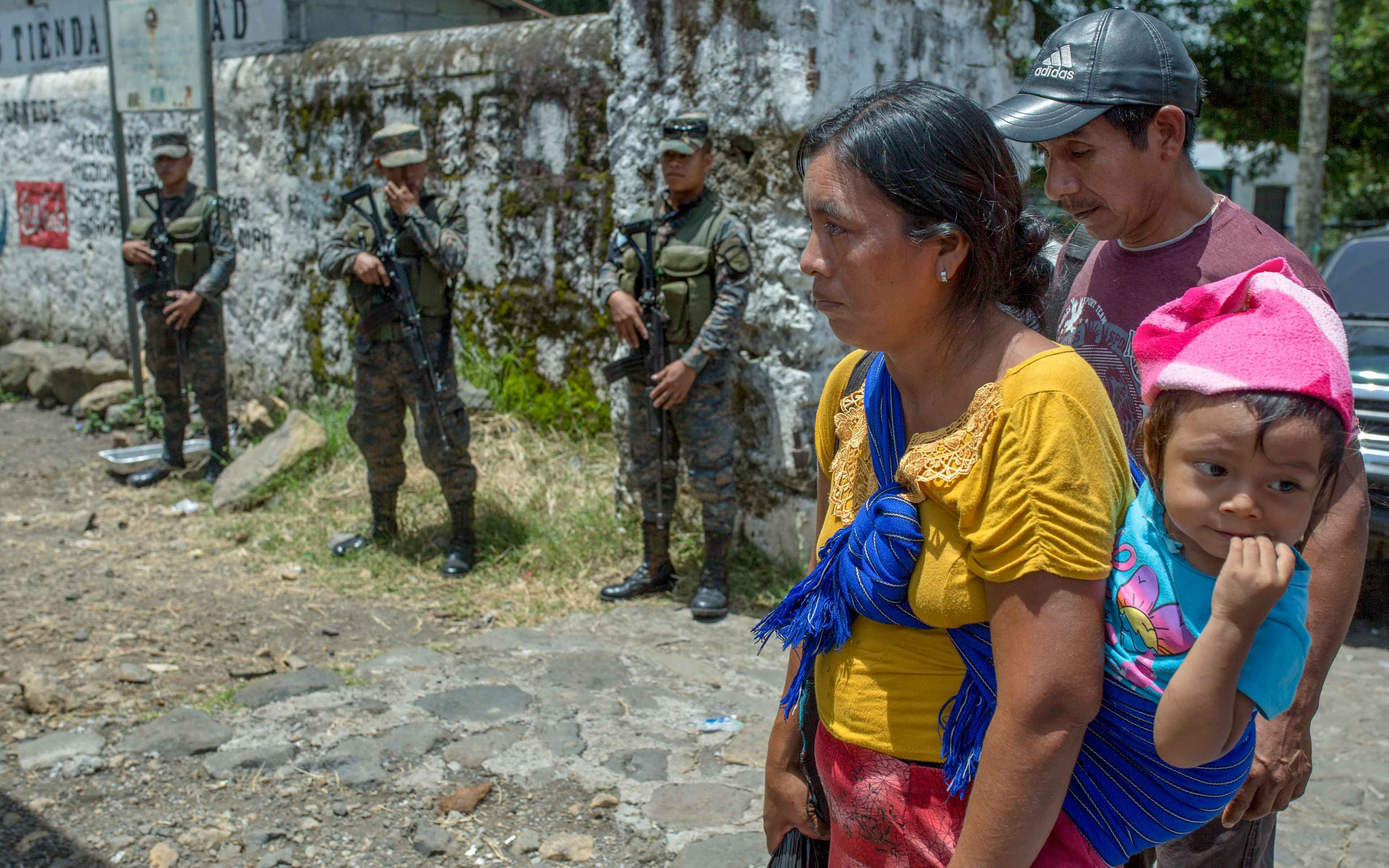 Many years after Guatemala's internal conflict, the same army that persecuted the ethnic Maya people in the western highlands is now carrying out a humanitarian mission to assist them in the evacuation of their new home in La Trinidad.