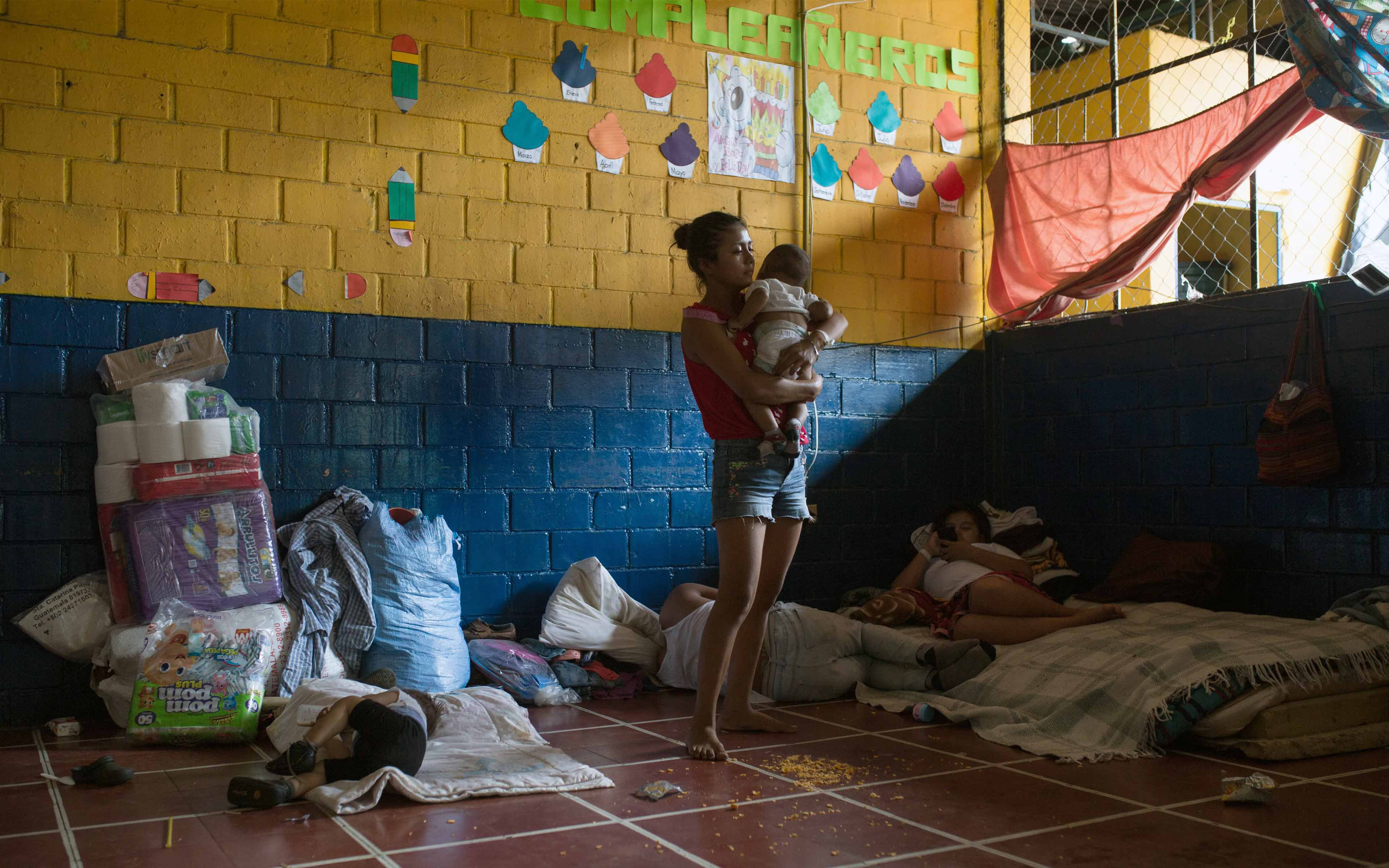 A family from La Reina, a community on the southern slope of the Fuego volcano, now lives in the Murray D. Lincoln School in Escuintla. One month after the June eruption of Fuego, 80 people are still living in the school. Oxfam provided hygiene items, water filters, and a gas stove to the school to support the people displaced by the eruption.