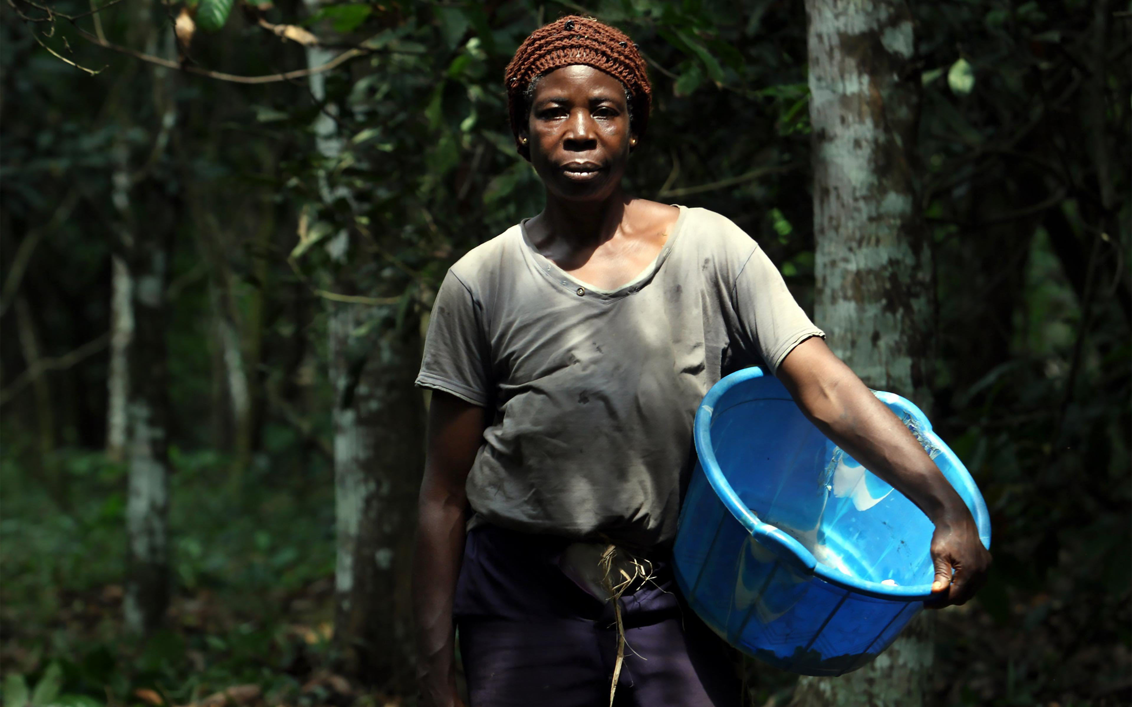 Anna Iyiola, a cocoa farmer, is pictured after harvest at her cocoa farm in Ayetoro-Ijesa, Nigeria. Our Behind the Brands campaign works to protect the rights of female cocoa farmers in companies' supply chains.