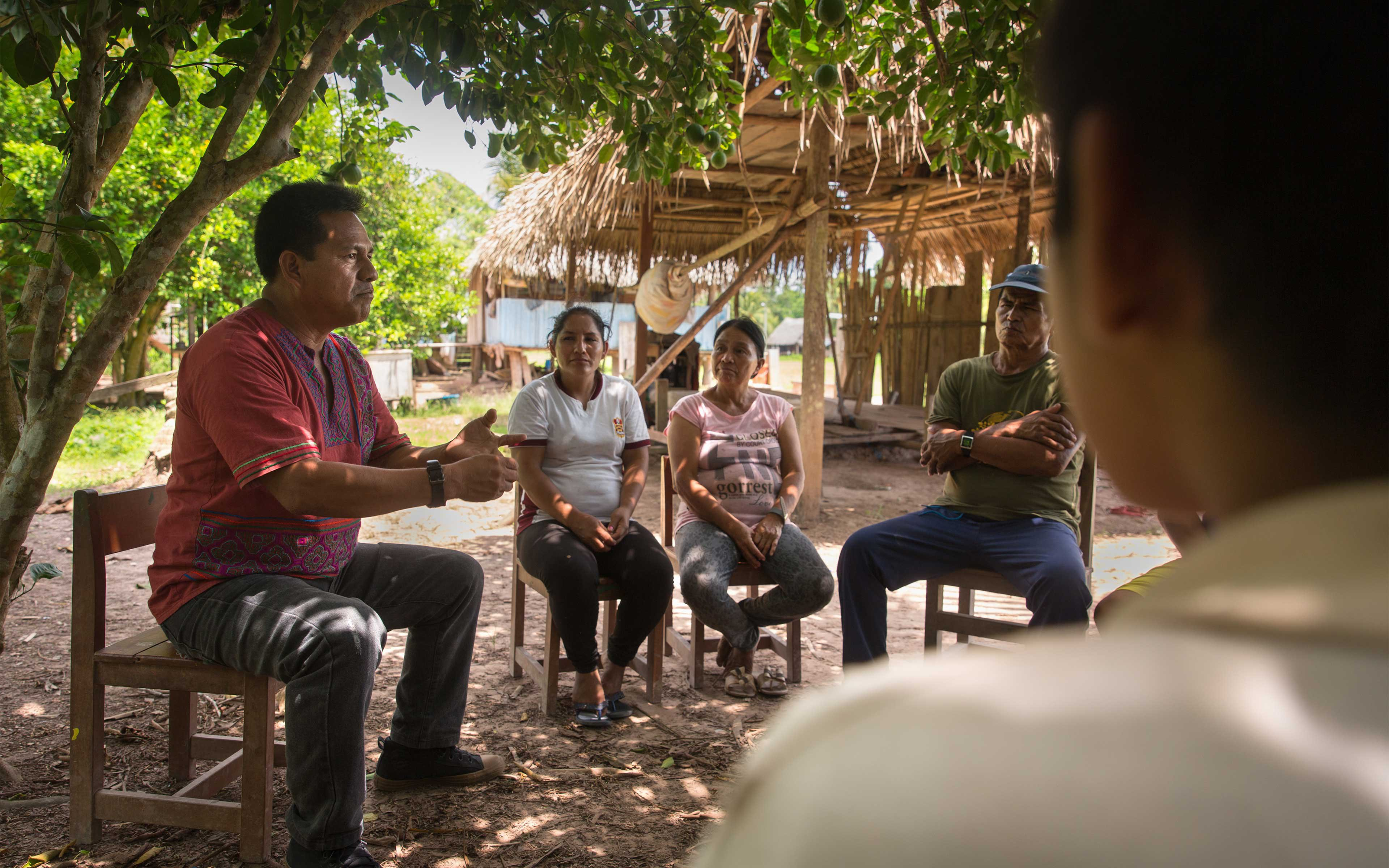 """Robert Guimaraes, leader of the Federation of Native Communities of Ucayalli (known as FECONAU), at a community meeting in Santa Clara de Uchunya. He says since the Ocho Sur plantation began clearing the forest four years ago, """"we've received death threats, and all sorts of accusations against me and others in the media."""""""
