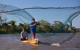 peru-fisherman-net-boat-river-ous-53330-h.jpg