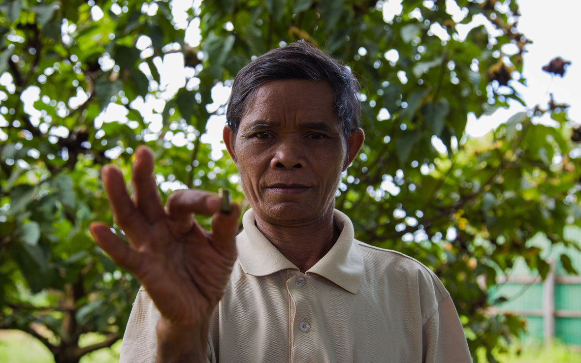 sal hnok holds a shell casing from a bullet fired at him in january 2012 when he insisted workers stop clear cutting the forest near his village in northern