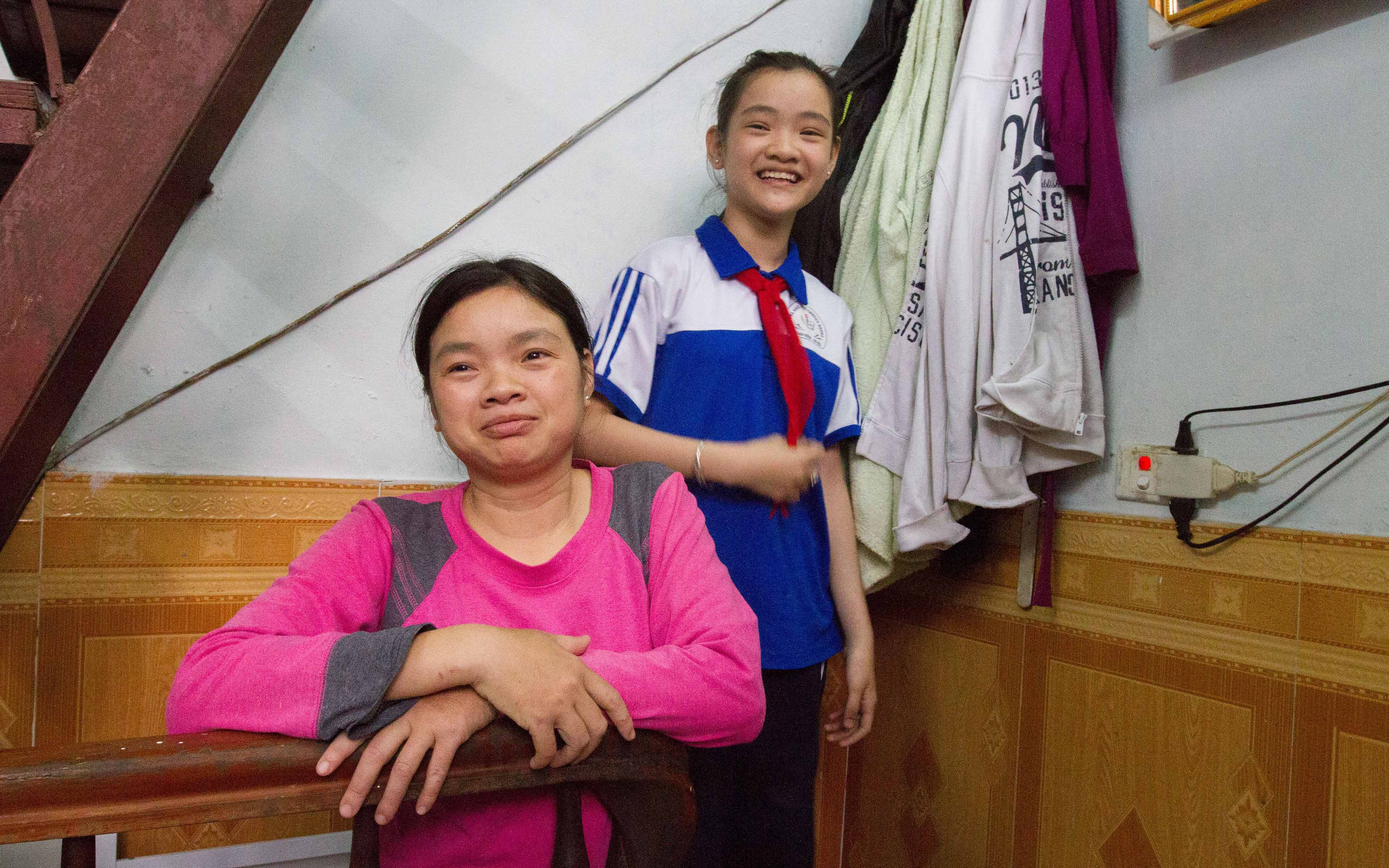 Phạm Thị Hậu and her daughter, Phạm Thảo Linh, in their home. She and her daughter moved to Hanoi after her husband died and his family shunned her.